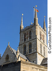 View of Southwark Cathedral tower and clock in London