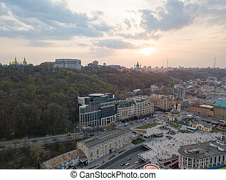view of St. Andrew's Church and the St. Michael's Monastery of the Golden Domes, the Ministry of the Interior and the Postal Square in Kyiv city
