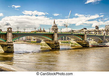 View of St Paul Cathedral over Southwark Bridge in London -...