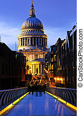 View of St. Paul\'s Cathedral in London from Millennium Bridge at night