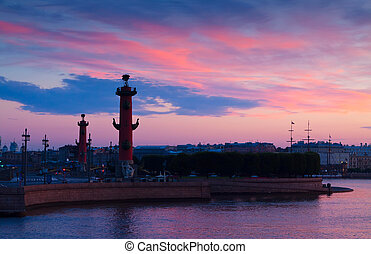 Rostral columns in summer morning - View of St. Petersburg....