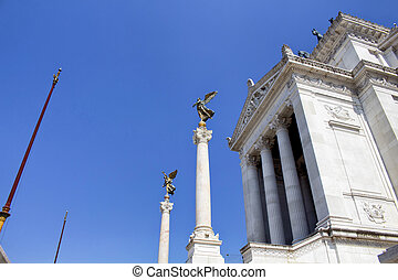 View of statues at Altar of the Fatherland in Rome. Grand marble, classical temple honoring Italy's first king & First World War soldiers.