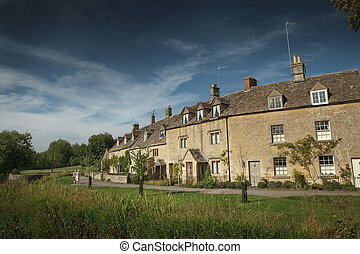 View of stone cottages in Lower Slaughter, Cotswold, England