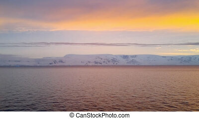 View of sunrise over Brabant Island seen from a cruise ship...