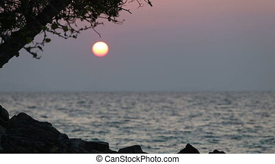 view of sunrise over sea from coast in thailand island