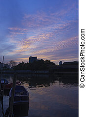 View of sunset at the canal in the city