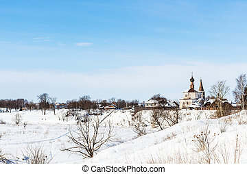 view of Suzdal with Holy Cross Church in winter