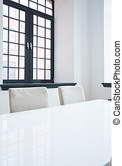 View of table - Vertical view of white table in dining hall...