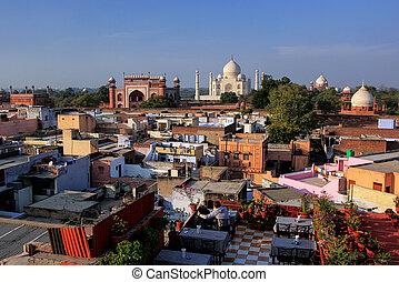 View of Taj Mahal from the rooftop restaurant in Taj Ganj neighborhood in Agra, India. Taj Mahal was build in 1632 by Emperor Shah Jahan as a memorial for his second wife Mumtaz Mahal.