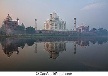 View of Taj Mahal with early morning fog reflected in Yamuna River, Agra, Uttar Pradesh, India