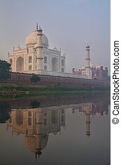View of Taj Mahal with early morning fog reflected in Yamuna River, Agra, Uttar Pradesh, India
