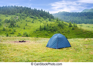 tent on meadow in mountains