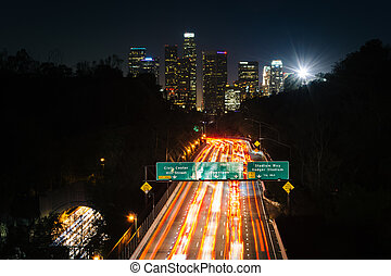 View of the 110 Freeway and downtown Los Angeles Skyline at nigh