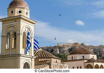 View of the Acropolis monument from Monastiraki Square as pegions fly by