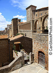 View of the ancient Italian city Pitigliano on the tuff rock, Tuscany, Italy