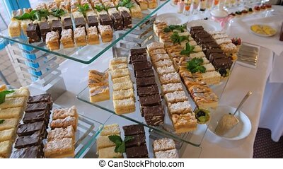 Appetizing cakes on a glass tray. - View of the Appetizing ...