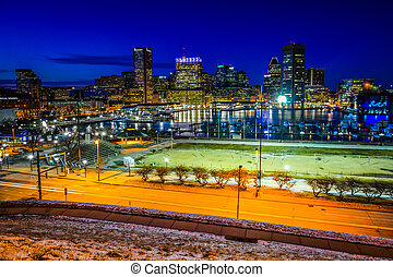 View of the Baltimore skyline and Inner Harbor at night, seen fr