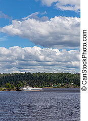 View of the bay shore in Ladoga Lake under a blue sky with clouds near Sortavala, Karelia. Russia