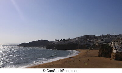 View of the beach at Albuferie, Portugal on sunny day