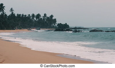 view of the beach of Sri Lanka, waves on the shore, slow...