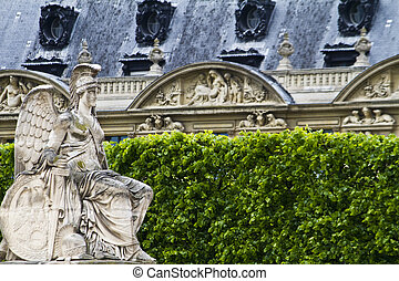 beautiful statues located on the Avenue des Champs-Elysees in Paris, France
