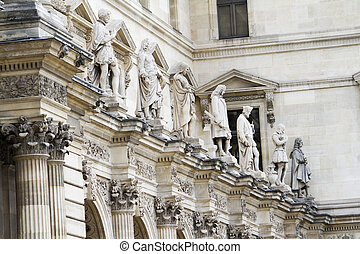 beautiful statues located on the Museum of the Louvre in Paris, France