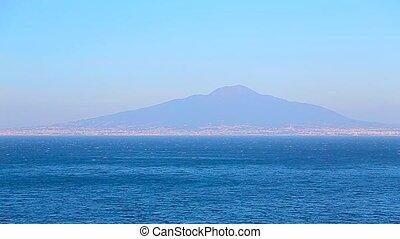 view of the blue sea and the volcano in the distance