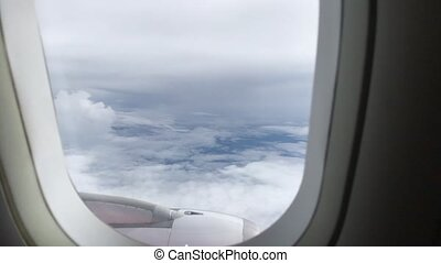 View of the blue sky and clouds through the window of the...