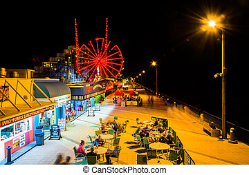 View of the boardwalk and ferris wheel at night in Daytona...