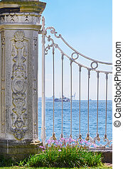 View of the Bosphorus through the white lattice of the Dolmabahche Palace. Istanbul, Turkey.