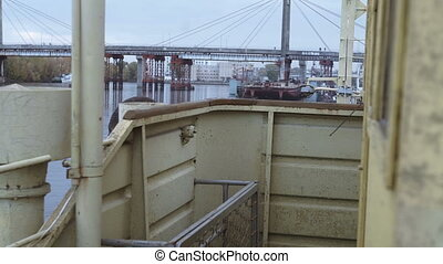 View of the bridge in shipyard from industrial boats