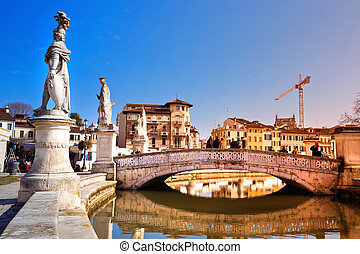 Padova - View of the canal with statues on Prato della Valle...