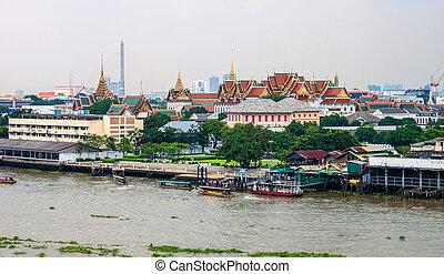 View of the Chao Phraya River and Royal palace in Bangkok, Thailand.