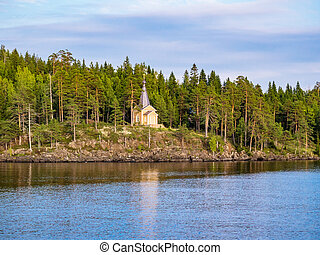View of the chapel standing on the shore