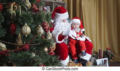View of the Christmas tree as a child playing with santa car