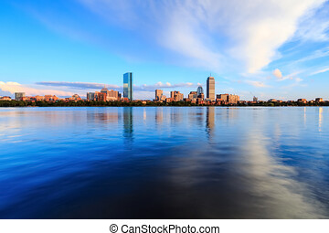View of the city from the water at sunset, city from the water with a beautiful sunset