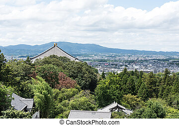 View of the city of Nara-shi on the top of the mountain on the roofs of houses.