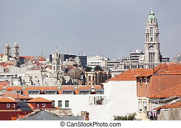 View of the city of Porto: houses around Ribeira and church...