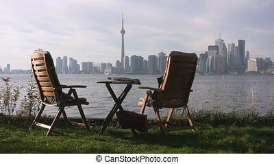 Two chairs with Toronto skyline in the background. View from Toronto Islands.