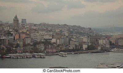 view of the city, pier with ships, Galata tower and flying...