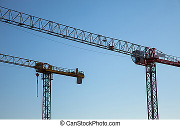 View of the construction place. Two cranes.
