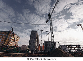 View of the construction site with cranes and high-rise residential buildings