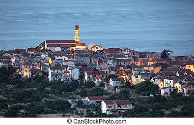 View of the Croatian town Betina at dusk