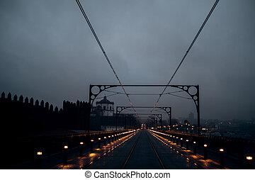 View of the Dom Luis I Bridge and railway tracks at night, Porto, Portugal.