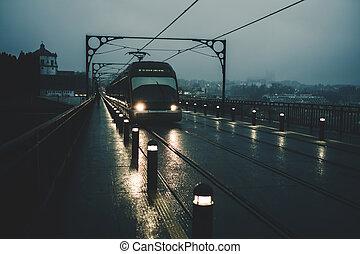 View of the Dom Luis I Iron Bridge and metro trains at night, Porto, Portugal.
