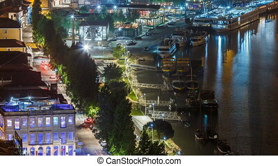 View of the Douro River and embankment timelapse at night in Porto, Portugal.