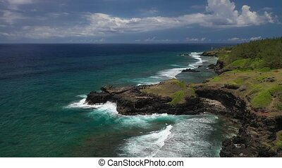 View of the famous Golden beach between black volcanic rocks on the banks of the Gris-Gris river, Mauritius. La Roche qui pleure.