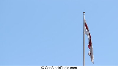 View of the flag of London against a blue sky