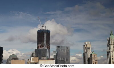 view of the freedom tower being built, where the twin towers...