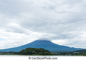 View of the Fuji mountain from the shore of the pond. Japan